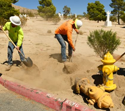 Workers placing a fire hydrant